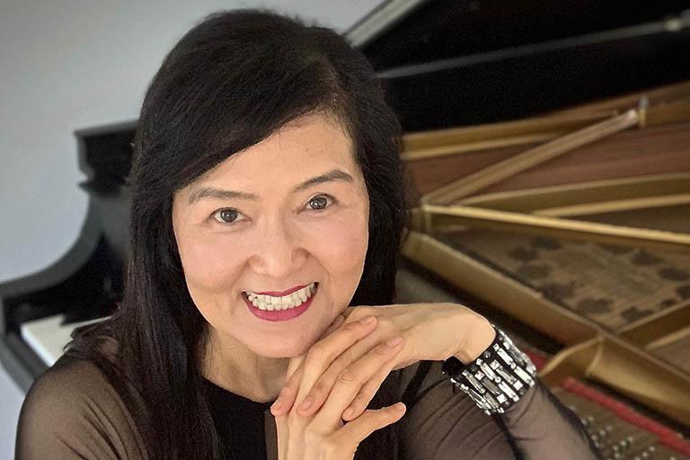 Junko sitting at piano